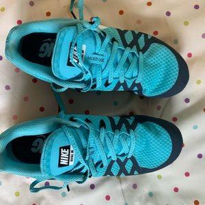Nike running spikes.